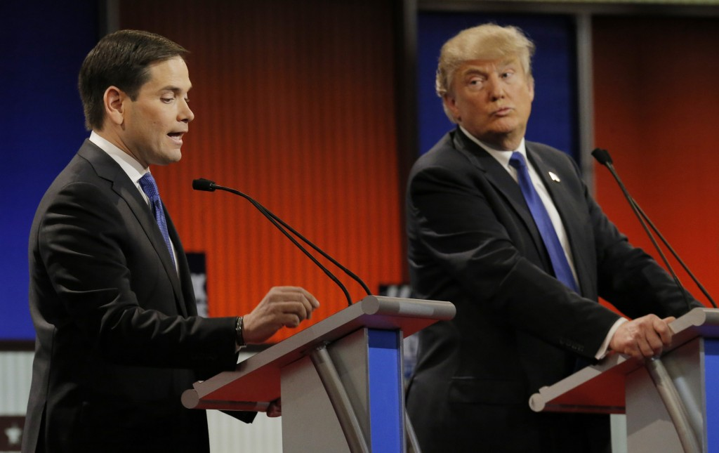 Republican U.S. presidential candidate Marco Rubio speaks as rival candidate Donald Trump (R) listens at the U.S. Republican presidential candidates debate in Detroit, Michigan, March 3, 2016. After Saturday's election results, Trump called for Rubio to end his campaign for the presidency.  Jim Young/Reuters