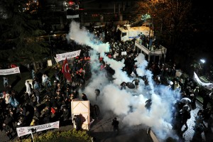 Riot police use tear gas to disperse protesting employees and supporters of Zaman newspaper at the courtyard of the newspaper's office in Istanbul, Turkey, late March 4, 2016. Selahattin Sevi/Zaman Daily/Reuters