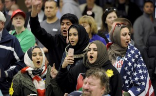Young Muslims protest Donald Trump before being escorted out during a campaign rally in Wichita, Kansas, March 5, 2016. Photo by Dave Kaup/Reuters