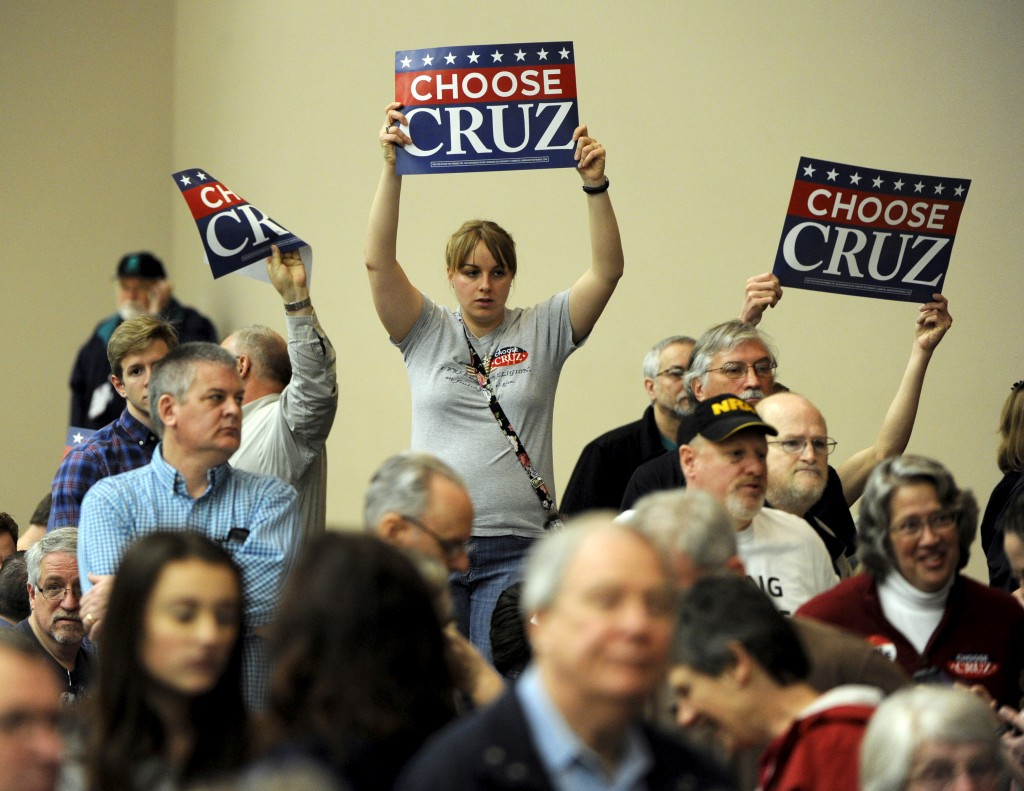 Supporters of U.S. Republican presidential candidate Senator Ted Cruz wave their signs at the Kansas Republican Caucus at the Century II Performing Arts and Convention Center in Wichita, Kansas March 5, 2016. REUTERS/Dave Kaup - RTS9GJ7