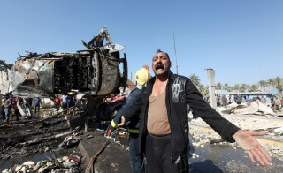 A man reacts at the site of a bomb attack that killed at least 60 people, mostly civilians, at a checkpoint in the city of Hillah, south of Baghdad, March 6, 2016.  Alaa Al-Marjani/Reuters