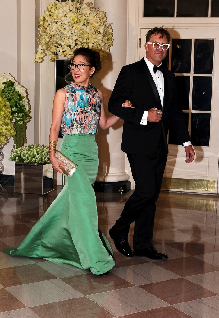 Actress Sandra Oh and Lev Rukhin arrive for the state dinner Thursday. Photo by Mary F. Calvert/Reuters