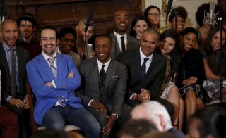 """Cast members from the hit musical """"Hamilton"""" listens as U.S. President Barack Obama speaks before their performance at the White House in Washington March 14, 2016.REUTERS/Kevin Lamarque - RTSAFJM"""