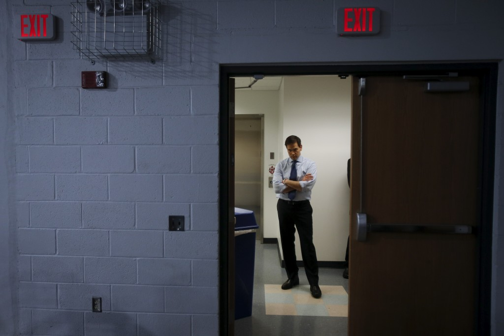 U.S. Senator and Republican presidential candidate Marco Rubio listens to the invocation from a backstage area before a campaign rally at Palm Beach Atlantic University in West Palm Beach, Florida, March 14, 2016.  REUTERS/Carlo Allegri      TPX IMAGES OF THE DAY      - RTSAG4Q