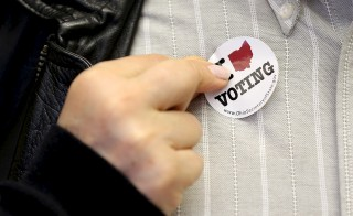 A Ohio voter has a sticker placed on him after casting his vote on Super Tuesday election in Valley City, Ohio March 15, 2016. Photo by Aaron Josefczyk/Reuters