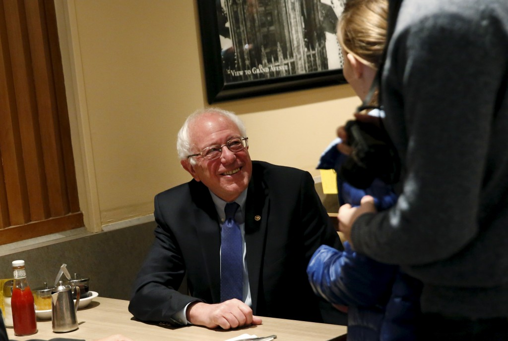 Democratic presidential candidate Bernie Sanders smiles after sitting down for breakfast at Lou Mitchell's restaurant and bakery in Chicago, Illinois on March 15. Photo by Shannon Stapleton/Reuters