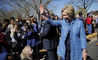 Democratic U.S. Presidential candidate Hillary Clinton talks to kids during campaign stop outside of a polling station in Raleigh, North Carolina March 15, 2016. Photo by Carlos Barria/Reuters
