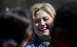 Democratic presidential candidate Hillary Clinton talks to supporters during a campaign stop outside of a polling station in Raleigh, North Carolina on March 15. Photo by Carlos Barria/Reuters