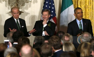 Vice President Joe Biden (left) reacts to comments by President Barack Obama (right) as Ireland's Prime Minister Enda Kenny (center) looks on during a St. Patrick's Day reception at the White House in Washington on March 15, 2016. Photo by Jonathan Ernst/Reuters