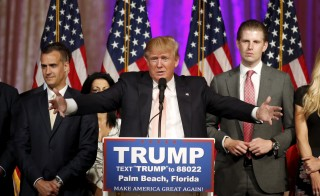 Republican presidential candidate Donald Trump stands between his campaign manager Corey Lewandowski (L) and his son Eric (R) as he speaks about the results of the Florida, Ohio, North Carolina, Illinois and Missouri primary elections during a news conference held in Palm Beach, Florida. Photo by Joe Skipper/Reuters
