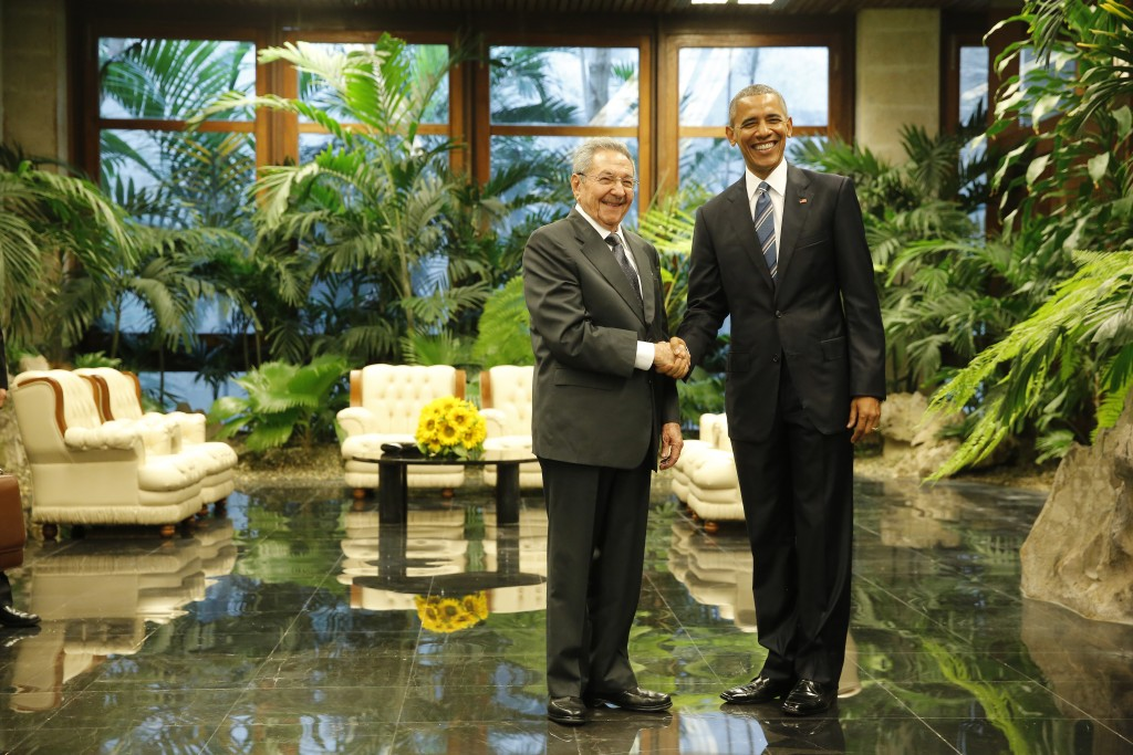 U.S. President Barack Obama and Cuba's President Raul Castro shake hands during their first meeting on the second day of Obama's visit to Cuba, in Havana Monday. Photo by Jonathan Ernst/Reuters