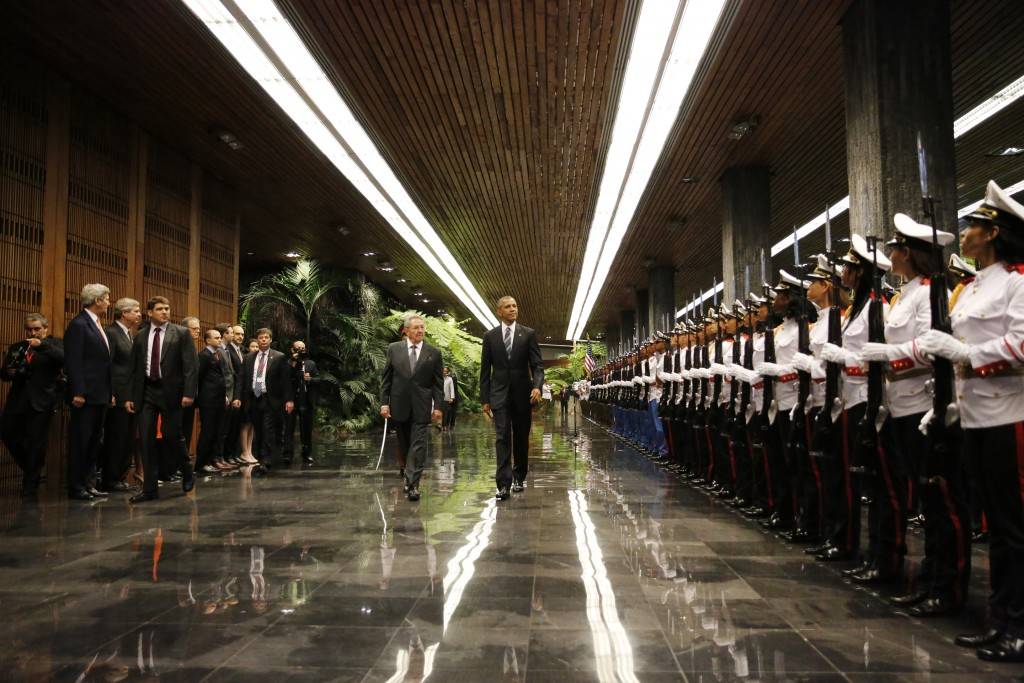 U.S. President Barack Obama and Cuba's President Raul Castro walk past honor guards during their first meeting on the second day of Obama's visit to Cuba. Photo by Carlos Barria/Reuters