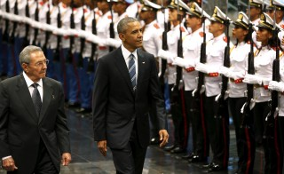 Cuban President Raul Castro (left) and U.S. President Barack Obama review Cuban soldiers during a welcome ceremony for Obama at the Palacio de la Revolucion in Havana in March. Photo by Jonathan Ernst/Reuters