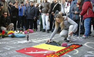 People gather around a memorial in Brussels following bomb attacks in Brussels, Belgium, March 22, 2016.    Photo by Charles Platiau/Reuters