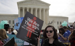 Supporters of contraception rally before Zubik v. Burwell, an appeal brought by Christian groups demanding full exemption from the requirement to provide insurance covering contraception under the Affordable Care Act, is heard by the U.S. Supreme Court in Washington March 23, 2016.      REUTERS/Joshua Roberts - RTSBXIB
