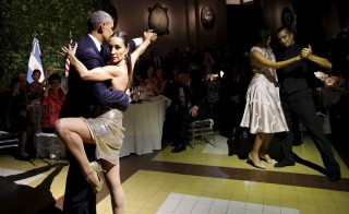 President Barack Obama and first lady Michelle Obama dance a tango during a state dinner hosted by Argentina's President Mauricio Macri at the Centro Cultural Kirchner as part of President Obama's two-day visit to Argentina, in Buenos Aires on March 23. Photo by Carlos Barria/Reuters