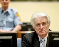 Ex-Bosnian Serb leader Radovan Karadzic sits in the court of the International Criminal Tribunal for former Yugoslavia in the Hague, the Netherlands March 24, 2016. Photo by Robin van Lonkhuijsen/Pool/via Reuters