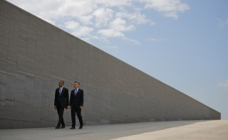 """U.S. President Barack Obama (left) and Argentina's President Mauricio Macri visit Parque de la Memoria (Remembrance Park), where they honored victims of Argentina's """"Dirty War"""" on the 40th anniversary of the 1976 coup that initiated the period of military rule, in Buenos Aires, on March 24. Photo by Carlos Barria/Reuters"""