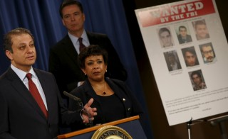 Manhattan U.S. Attorney Preet Bharara (L-R), Federal Bureau of Investigation Director James Comey and U.S. Attorney General Loretta Lynch hold a news conference to announce indictments on Iranian hackers for a coordinated campaign of cyber attacks in 2012 and 2013 on several U.S. banks and a New York dam, at the Justice Department in Washington March 24, 2016. REUTERS/Jonathan Ernst - RTSC30U