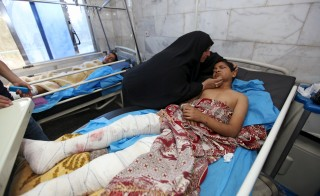 A boy, who was wounded by a suicide bombing at a soccer field, lies in a hospital in Iskandariya, Iraq March 26, 2016. At least 41 people were killed in the attack, while many of the victims were children. Alaa Al-Marjani/Reuters