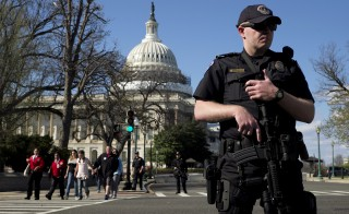 A U.S. Capitol police officer guards the perimeter on Independence Avenue in front of the Capitol Building as visitors are evacuated after a shooting at the Capitol Visitors Center. Photo by Joshua Roberts/Reuters