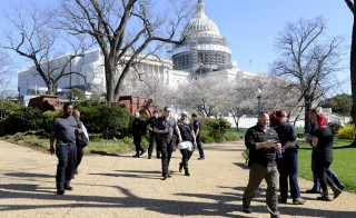 Police direct tourists away from the perimeter of the U.S. Capitol, after a shooting at the Capitol Visitors Center, in Washington on Monday. Photo by Mike Theiler/Reuters