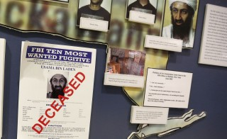 "The FBI's Ten Most Wanted Fugitive poster for Osama Bin Laden with the word ""DECEASED"" printed in red across it hangs on the wall at the FBI Headquarters in Washington, D.C. The Obama administration released another batch of documents Tuesday that were seized in a May 2011 raid that killed bin Laden in Abbottabad, Pakistan. Photo by Larry Downing/Reuters"