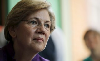 Sen. Elizabeth Warren listens to workers tell their stories about erratic workplace schedules at the Equal Exchange Cafe in Boston, Massachusetts in 2015. Photo by Brian Snyder/Reuters