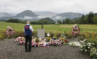 Wreaths of flowers are seen near the stele after families gathered for a ceremony in memory of the victims of the Germanwings Airbus A320 crash in Le Vernet, France, July 24, 2015. Families of the 150 people who died after a Germanwings plane crashed into the French Alps in March gathered in Le Vernet to attended a religious ceremony. An extensive report was released Sunday by French authorities. Robert Pratta/Reuters