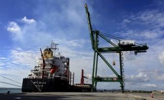 A ship is anchored next to cranes at the Mariel port in Artemisa province, Cuba on Jan. 5, 2016. Photo by Enrique de la Osa/Reuters