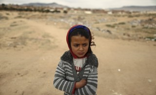 Shahda, 8, stands at the impoverished Zhor neighborhood of Kasserine, where young people have been demonstrating for jobs since last week, January 28, 2016. REUTERS/Zohra Bensemra - RTX24F7E
