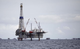 A view of a drilling rig and distant production platform in the Soldado Field off Trinidad's southwest coast in this September 10, 2011 file photo. Photo by Andrea De Silva/Reuters