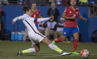 Feb 10, 2016; Frisco, TX, USA; United States midfielder Carli Lloyd (10) pokes the ball into the Costa Rica zone during the second half at Toyota Stadium. United States defeats Costa Rica 5-0. Mandatory Credit: Jerome Miron-USA TODAY Sports - RTX26F49