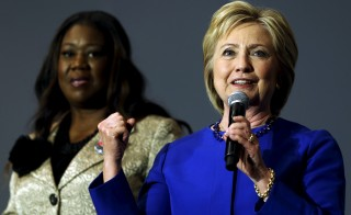 U.S. Democratic presidential candidate Hillary Clinton (R) gives remarks after being endorsed by Sybrina Fulton (L), mother of shooting victim Trayvon Martin, and other families of gun violence victims during a town hall meeting at Central Baptist Church in Columbia, South Carolina February 23, 2016. REUTERS/Jonathan Ernst - RTX28AFZ