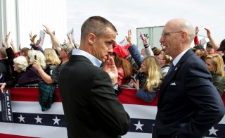 Republican presidential candidate Donald Trump's campaign manager Corey Lewandowski speaks with an unidentified aide after a demonstrator was detained at a rally at the Dayton International Airport in Dayton, Ohio. Photo by William Philpott/Reuters