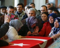 Family members and relatives of car bombing victim Murat Guel mourn over a coffin holding his body in a mosque in Ankara, Turkey, March 14, 2016. REUTERS/Umit Bektas  - RTX291ID