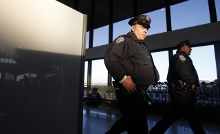 Police walk through Terminal A at Newark Liberty Airport shortly after reopening it to passengers in Newark, New Jersey December 20, 2010. Security forces began allowing passengers back into Newark Airport's Terminal A after the terminal was shut for more than half an hour early on Monday because of a suspicious package, a Reuters witness said. Officials determined the suspicious package contained a computer monitor, 1010 WINS radio reported. REUTERS/Jessica Rinaldi (UNITED STATES - Tags: SOCIETY CRIME LAW TRANSPORT CIVIL UNREST) - RTXVWNH