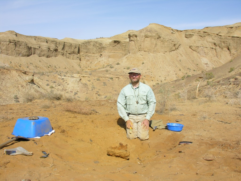 Hans Sues, a scientist at the Smithsonian's National Museum of Natural History, excavating a dinosaur fossil at Dzharakuduk in the Kyzylkum Desert of Uzbekistan, September 2006. Photo by Hans Sues, Smithsonian.
