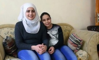 Sajeda, pictured here in Jordan with one of her younger sisters, received a letter and care package from the Kissells in Colorado. Image by Carey Wagner/CARE