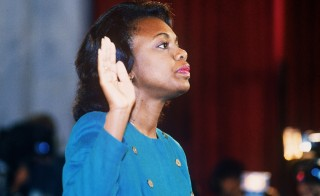 Law professor Anita Hill takes the oath before the Senate Judiciary Committee on Oct. 12, 1991. Photo by Jennifer Law/AFP/Getty Images
