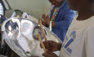 A student plays with the Austin Community Steelpan Band. Photo courtesy of KLRU