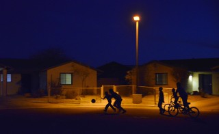 The U.S. Commission on Civil Rights will look at how life has improved for American Indian and Alaska Native communities in a report coming out this year. Kids play in the street on the Pascua Yaqui Indian Reservation. Michael Valenzuela, the reservation's chief of police said, This is our goal. Kids running in the street, bicycling, going to the ice cream truck.  (Photo by Jahi Chikwendiu/The Washington Post via Getty Images)