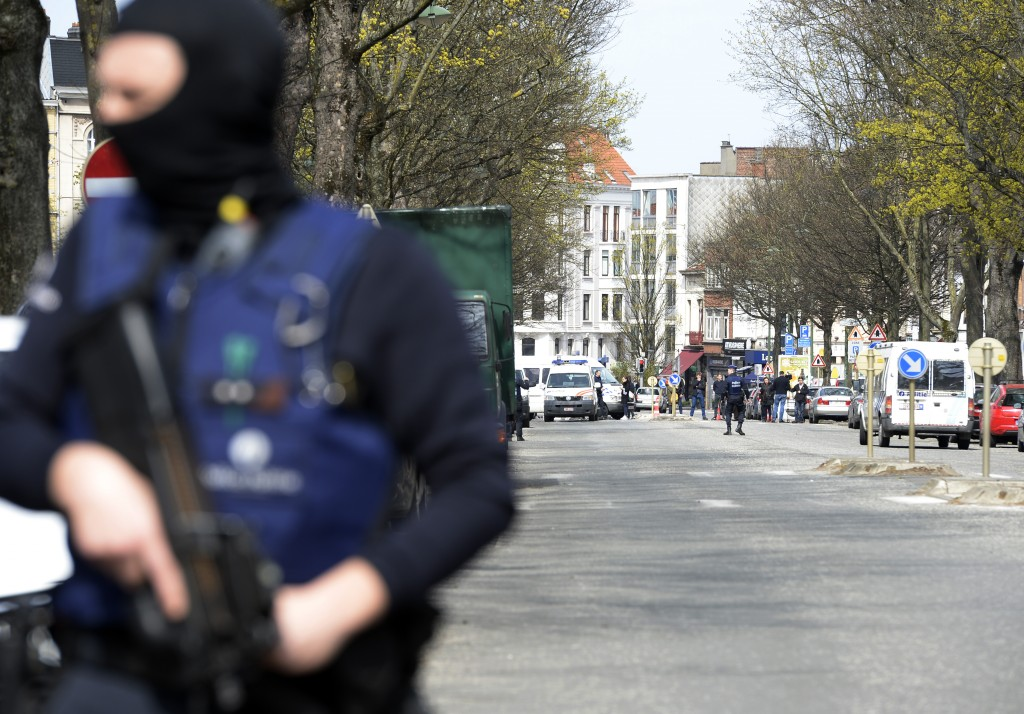 Belgian police officers stand guard in a street in Etterbeek, Brussels, as part of the investigation into the November 13 Paris attacks in which 130 died and the March 22 attacks which left 32 dead in Brussels. A sixth person was arrested during raids on April 8 over the Brussels airport and metro bombings which netted top Paris attacks suspect Mohamed Abrini, the Belgian prosecutor's office said. The prosecutor had said on April 8 that five people had been been arrested but a spokesman confirmed Saturday that a sixth was being held. Thierry Charlier/AFP/Getty Images