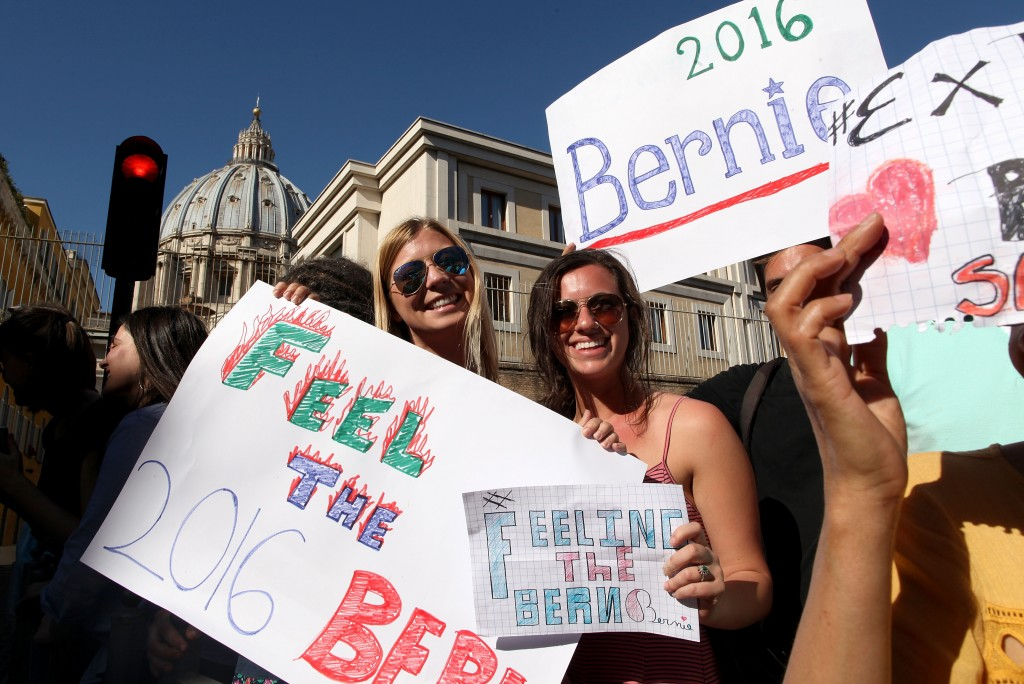 VATICAN CITY, VATICAN - APRIL 15:   Supporters of U.S. Democratic presidential canditate Bernie Sanders hold signs outside the 'Centesimus Annus 25 Years Later Symposiumon' at the Casina Pio IV April 15, 2016 in Vatican City, Vatican. Candidate Bernie Sanders came to Rome to attend a conference sponsored by the Pontifical Academy of Social Sciences marking the 25th anniversary of Pope St. John Paul II's social encyclical 'Centesimus Annus.'  (Photo by Franco Origlia/Getty Images)