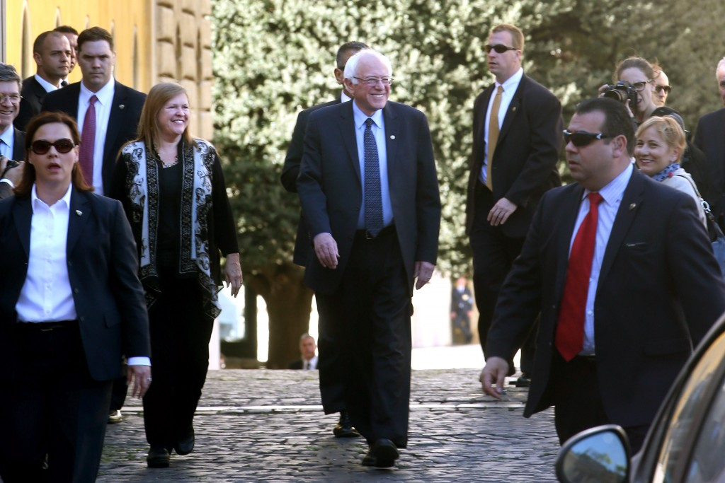 VATICAN CITY, VATICAN - APRIL 15:   U.S. Democratic presidential canditate Bernie Sanders (C) leaves with his wife Jane O'Meara Sanders from the 'Centesimus Annus 25 Years Later Symposiumon' at the Casina Pio IV April 15, 2016 in Vatican City, Vatican. Candidate Bernie Sanders came to Rome to attend a conference sponsored by the Pontifical Academy of Social Sciences marking the 25th anniversary of Pope St. John Paul II's social encyclical 'Centesimus Annus.'  (Photo by Franco Origlia/Getty Images)