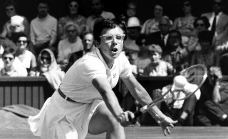 Tennis champion Billie Jean King is pictured on Centre Court at the 1969 Wimbledon. The sports icon challenged the gender disparity in the sport amid women's struggle for equality in the 1970s. Photo by Popperfoto/Getty Images