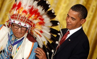 "President Barack Obama (R) presents the Medal of Freedom to Crow War Chief Dr. Joseph Medicine Crow, also known as ""High Bird"" during a ceremony in the White House in August 2009, in Washington, D.C. Photo by Chip Somodevilla/Getty Images"
