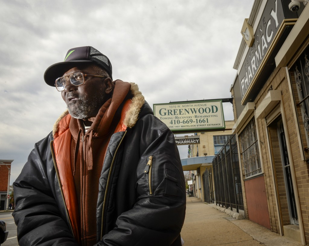 Ellis Basnight, 71, says he relies on the independent Keystone Pharmacy, which is a 15-minute walk from his house. Keystone's been in the neighborhood for decades, and was one of the stores looted in last spring's protests. Photo by Doug Kapustin for Kaiser Health News