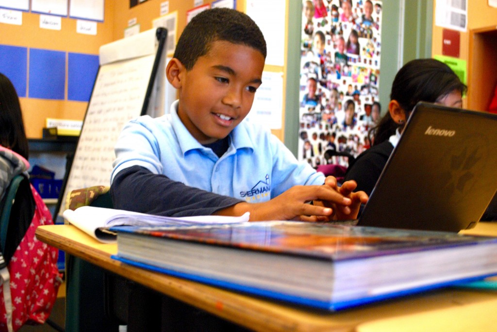 Derrick Fields, 9, works on his assignment during a Spanish-language history lesson at Sherman Elementary School in San Diego, California. Photo by Lillian Mongeau/The Hechinger Report