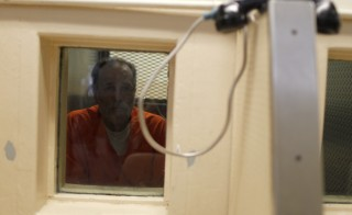 An inmate waits for a visitor at the California Institution for Men state prison in Chino, California. The Obama administration said its proposal would make it easier for ex-convicts to secure work if inquiries about their criminal history were delayed until an offer of employment has been made. Photo by Lucy Nicholson/Reuters